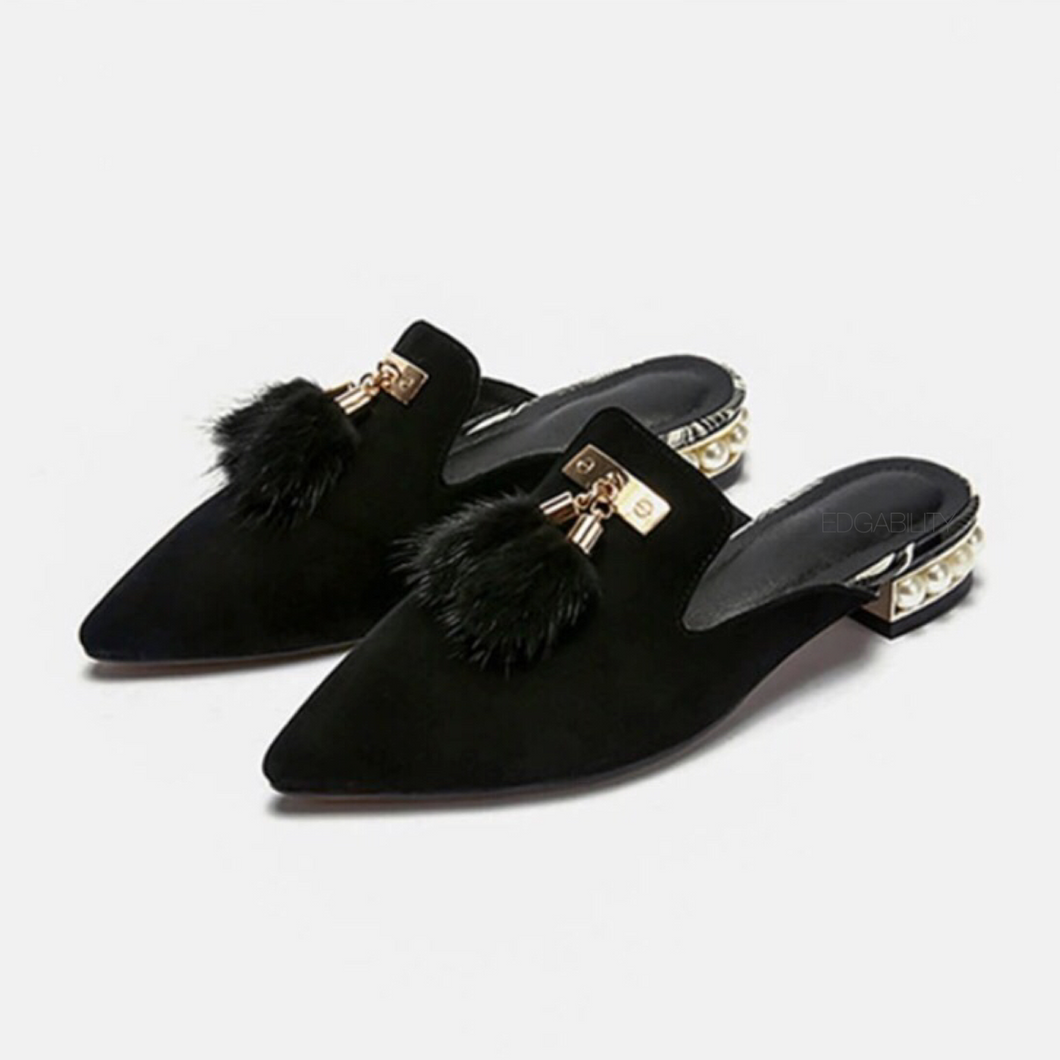 fur tassles on black flats angle view edgability