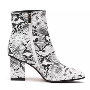 snakeskin boots ankle boots heeled boots edgability side view
