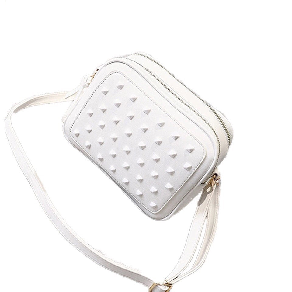 monotoned white studded unisex sling bag edgability