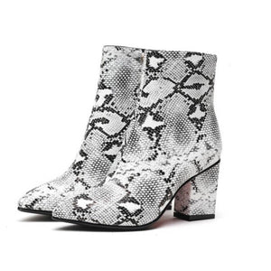 snakeskin boots ankle boots heeled boots edgability front view