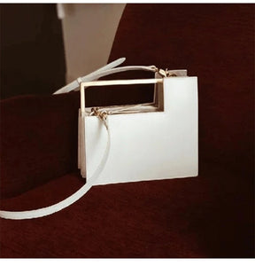 geometric classy white bag with gold handle edgability full view