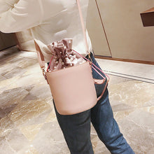 pink studded bag bucket bag drawstring bag edgability model view
