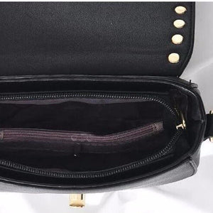 black gold studded handbag inside view edgability