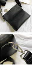 black clutch bag with safety pin edgability detail view