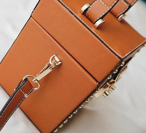 tan studded bag box bag edgability side view