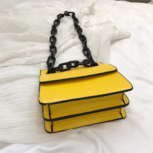 croc skin yellow sling bag with black strap edgability bottom view