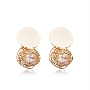 statement earrings gold earrings with pearls edgability