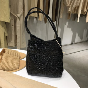 croc skin black bucket bag edgy fashion edgability front view