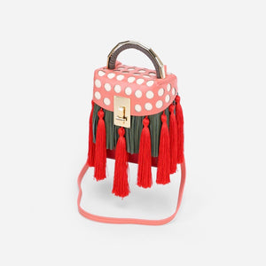 quirky box bag with red tassels edgability angle view