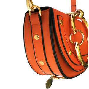orange wristlet studded bag sling bag edgability side view