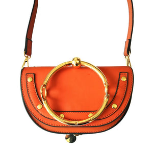 orange wristlet studded bag sling bag edgability front view