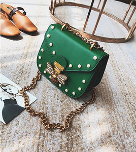 pearl studded butterfly green bag edgability top view