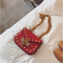 pearl studded butterfly red bag edgability top view
