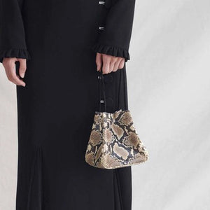 snakeskin brown grey bucket bag edgability model view