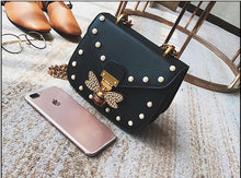 pearl studded butterfly black bag edgability top view