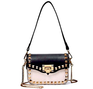 black and beige handbag with gold studs edgability
