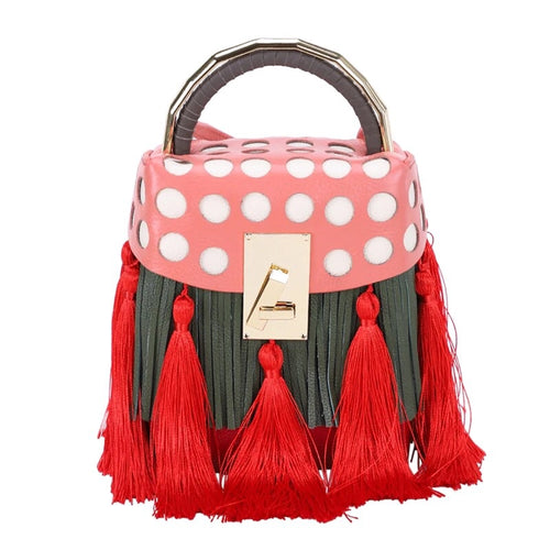 quirky box bag with red tassels edgability