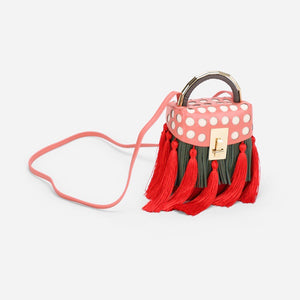 quirky box bag with red tassels edgability front view