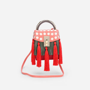 quirky box bag with red tassels edgability full view