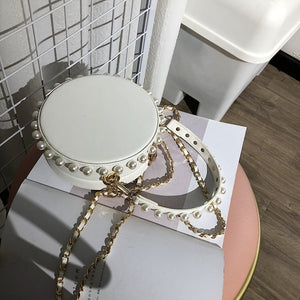 pearl studded white bag box round bag edgability top view