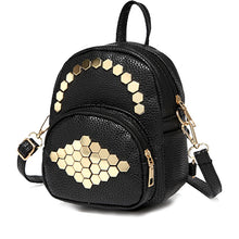 gold studs on black mini backpack angle view edgability