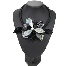 black gray statement necklace with exotic floral design edgability model view