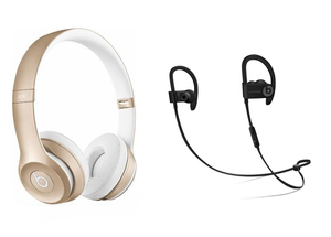 Gold Beats Headphones and a pair of Bluetooth Earphones