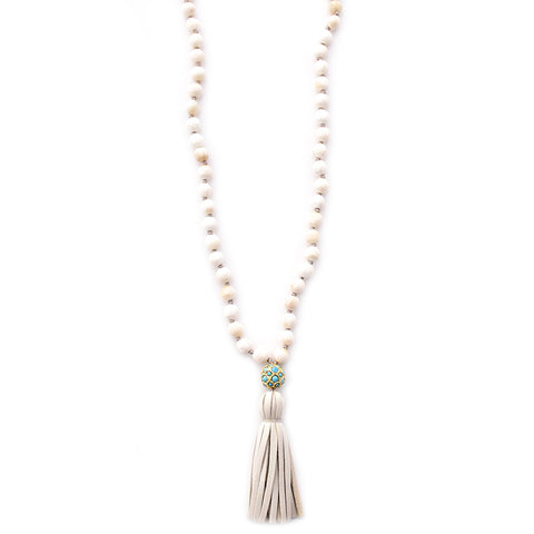 shell, turquoise ball & leather tassel