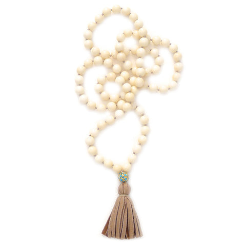 knotted coral with turquoise ball & tassel