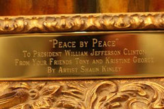"The plaque beneath ""Peace by Peace"""