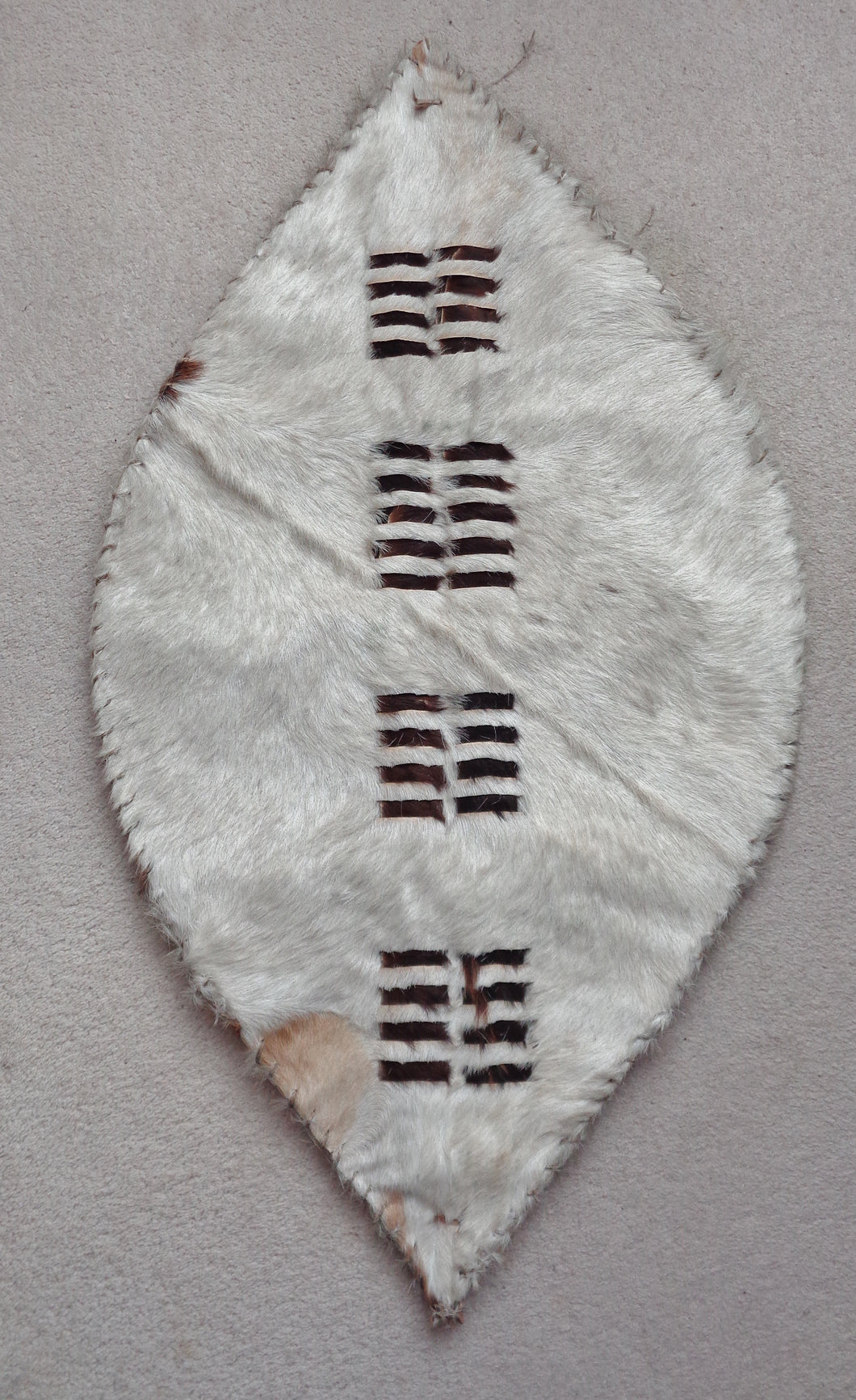 DISPLAY PIECE IN THE SHAPE OF A ZULU SHIELD