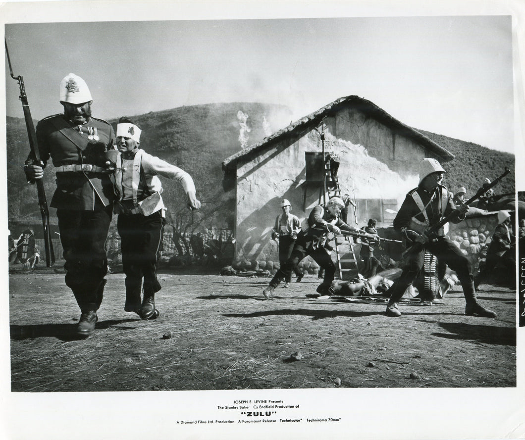 Black & White Press Still from 'ZULU' - Bourne Helping Evacuate Burning Hospital