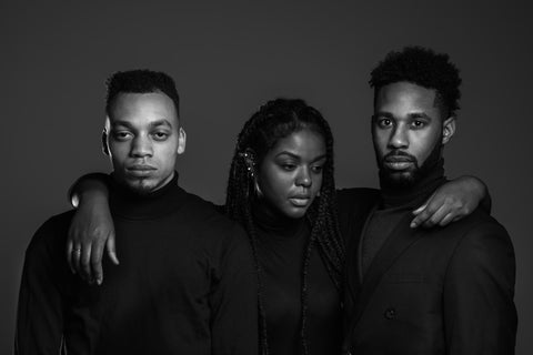 Two Black men and a Black woman wearing Black shirts with Black and White overlay