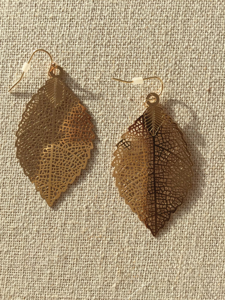 Gold toned laser cut leaf earrings