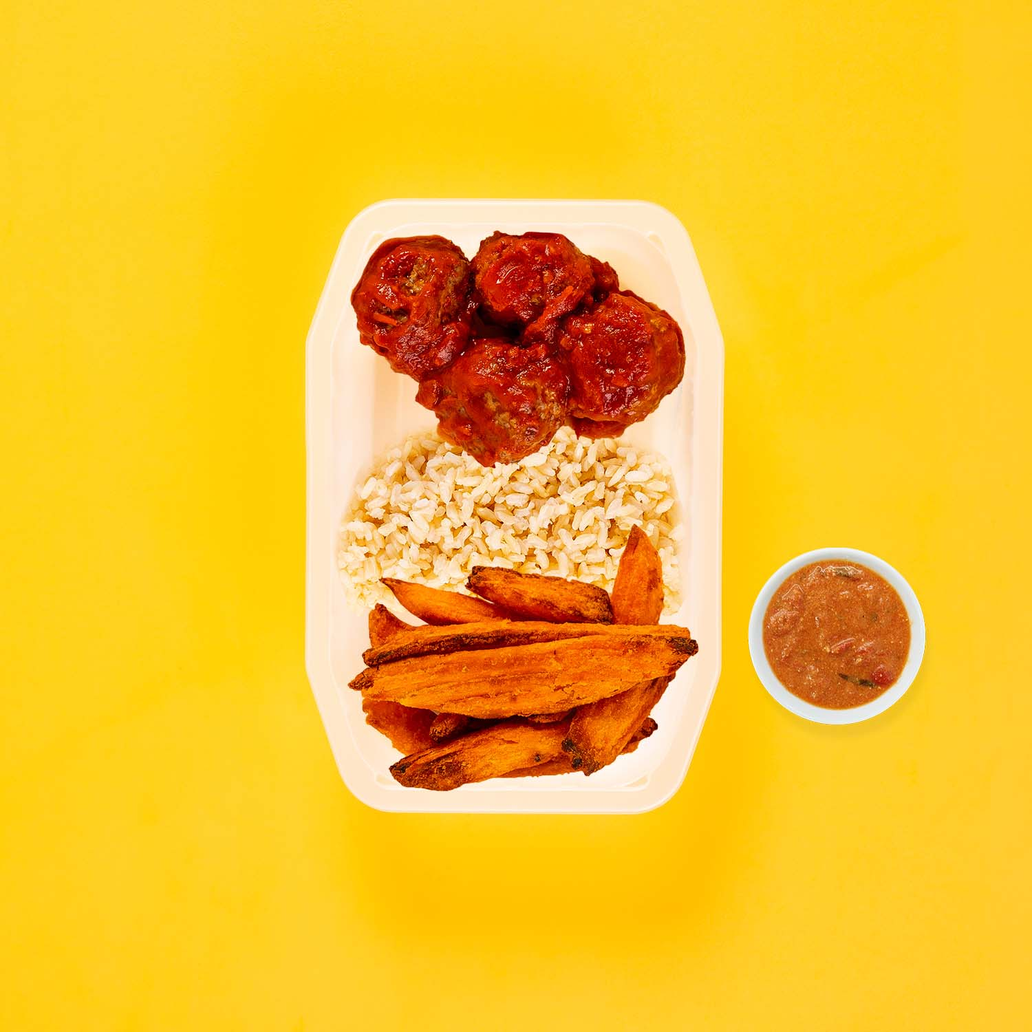 100g Beef Meatballs 100g Brown Rice 150g Sweet Potato Wedges Thai Red Curry