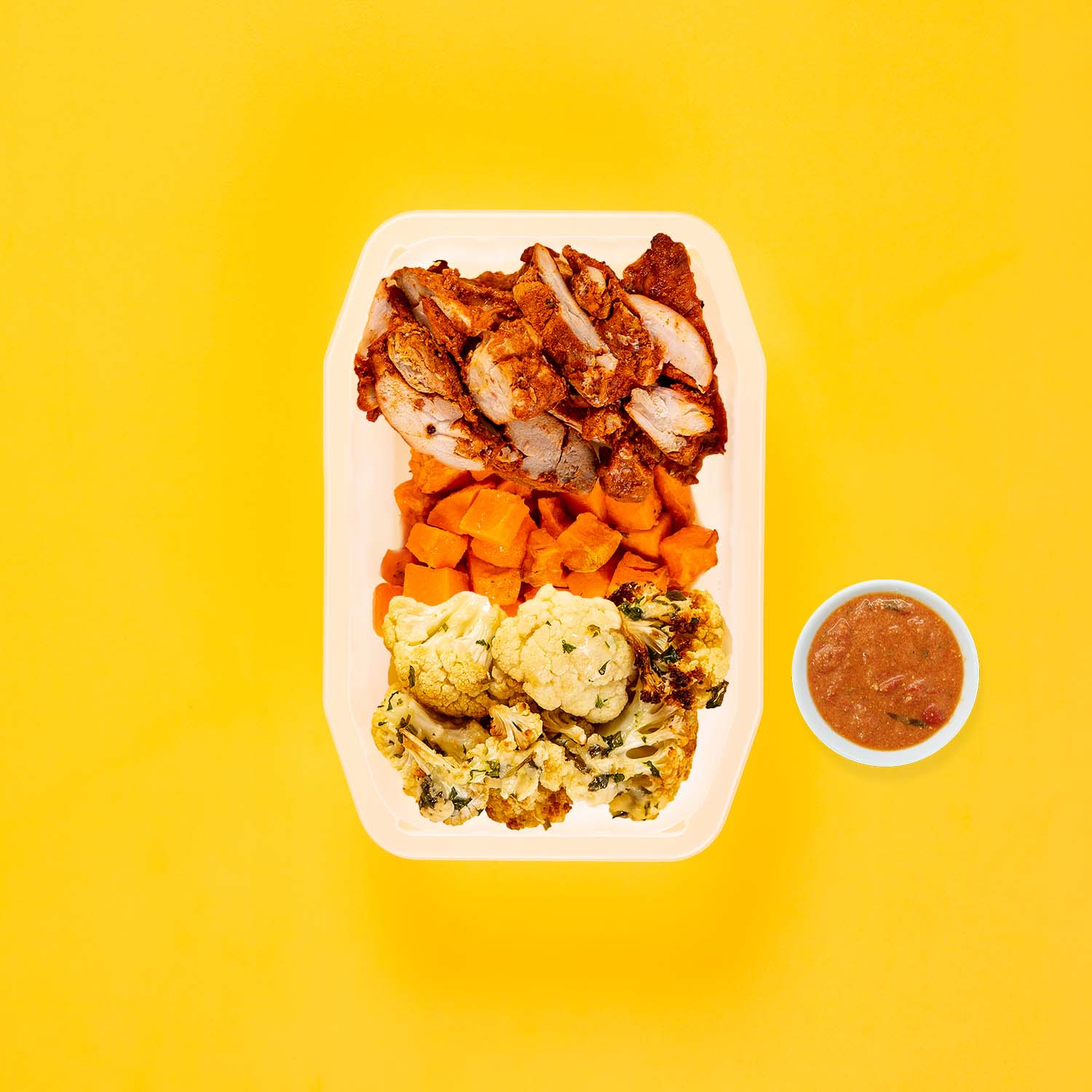 150g Chipotle Chicken Thigh 100g Rosemary Baked Sweet Potato 200g Parmesan Cauliflower Thai Red Curry