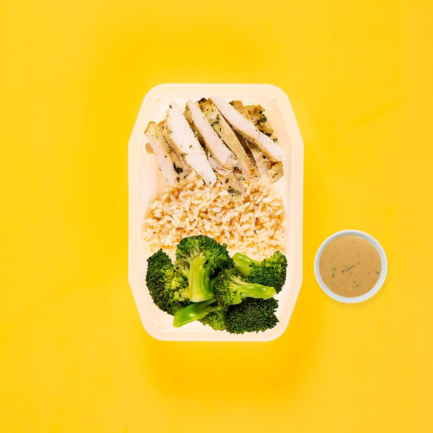 50g Garlic Herb Chicken Breast 100g Brown Rice 200g Broccoli Satay Sauce