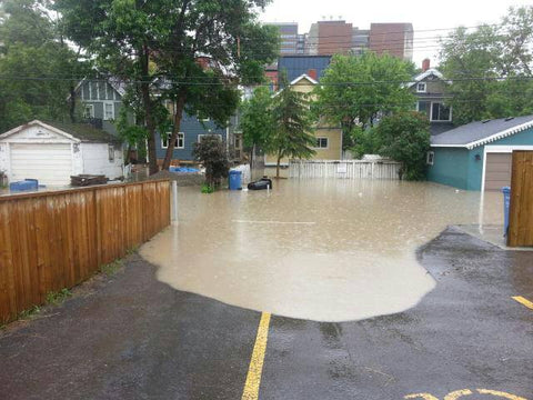 Picture of the waters rising dangerously close to the house during the 2013 flood in Calgary.
