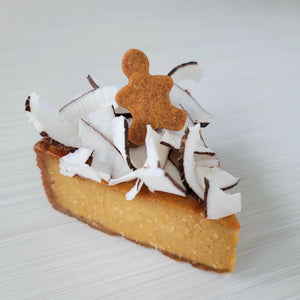 Enjoy a gingerbread crust, a coconut, almond & praline flan topped with shredded coconut and a little cookie!