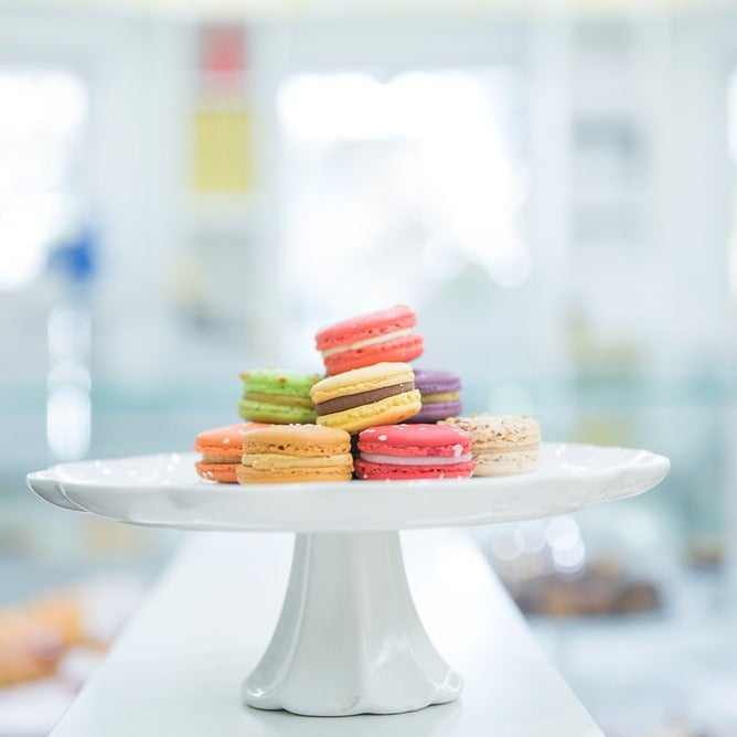 What 12 macarons look like on a cake stand.