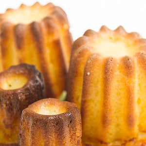 A canelé is a small French pastry that eceryone should try at least once in our bakery!