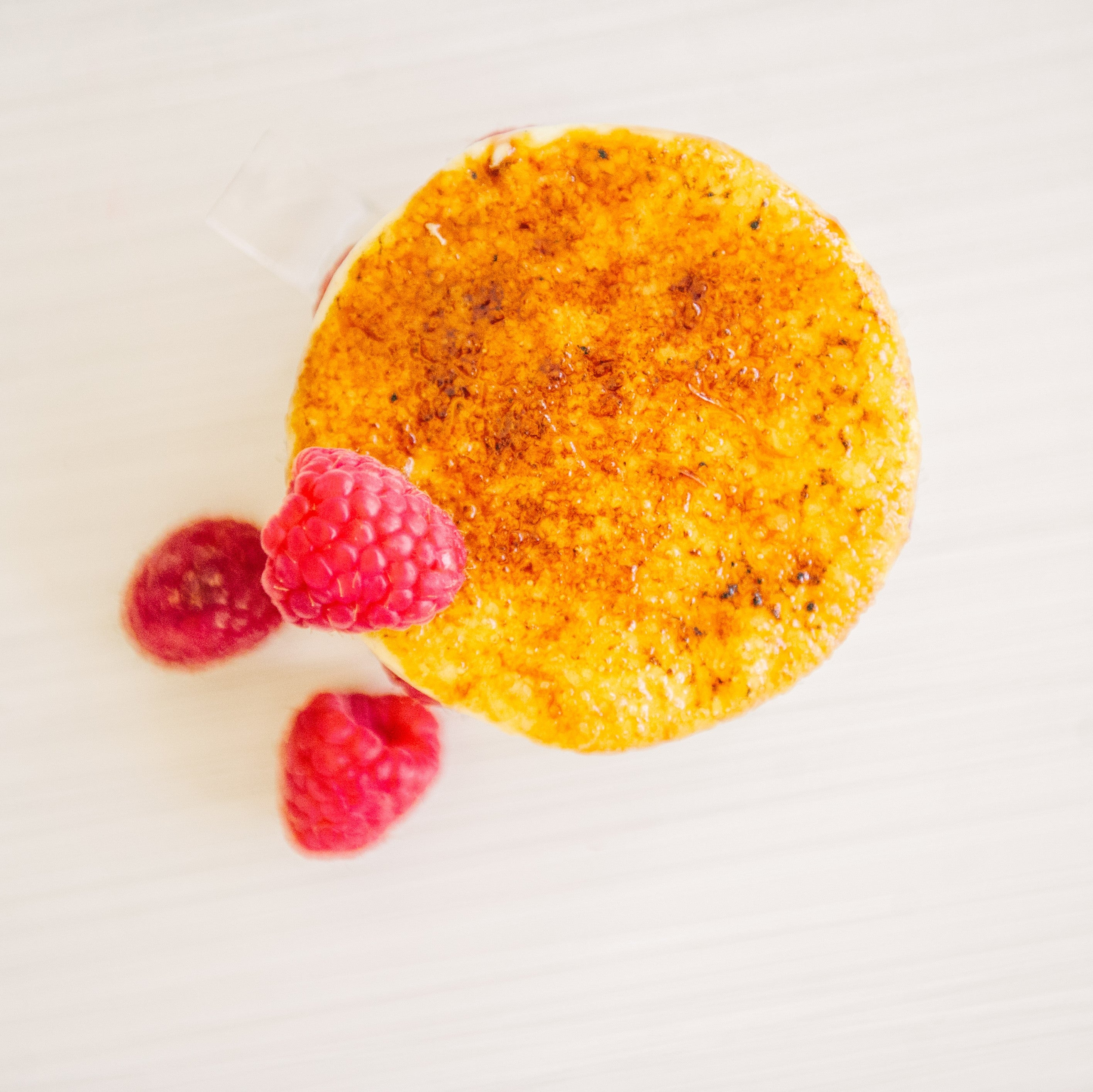 Fresh raspberries and rhubarb with creme brulee for this September feature at Yann Haute Patisserie in Calgary