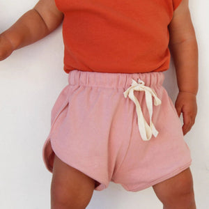 Ribbed cotton kids shorts. In blush and coral. Drawstring waist. Cotton. Kids clothing. Affordable Australian kids clothing. Little Indahs