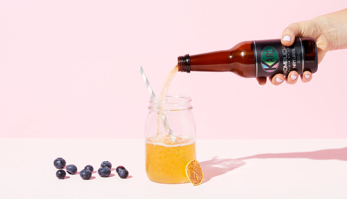 Kombucha Being Poured into Glass Showing Fizzy and Carbonated Kombucha