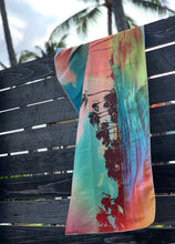 TROPICS surfer towel hanging on a fence by Matthew Allen - Double sided, quick drying and made from eco friendly material!