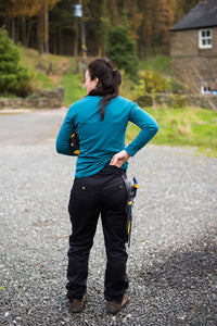 Back view of Becky wearing trousers. Workwear for Women. Hoydens; Tough trousers for tough women.