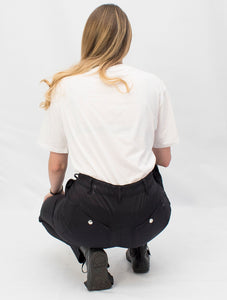 Sophie in studio, back view, squatting. Workwear for Women. Hoydens; Tough trousers for tough women.
