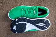 Green running shoe top down and sole