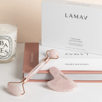 LaMav Quartz Gua Sha and Roller. Encourages skin cell rejuvenation stimulates lymphatic drainage, helps reduce inflammation and increases the skin's absorption of bio-actives.  Shop at Skinbase Beauty.