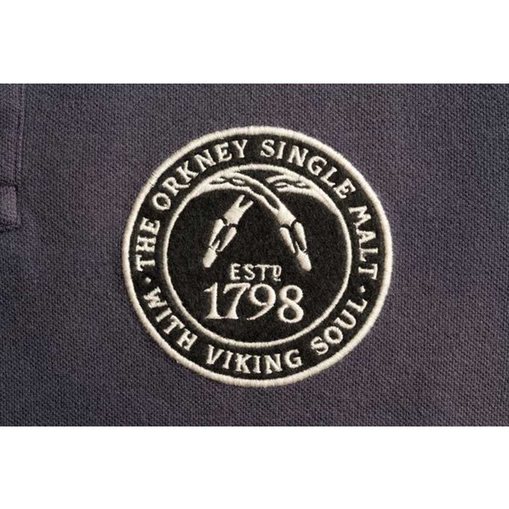 Highland Park Serpent Head Polo Shirt close up of badge